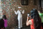 180801-N-DA737-0057 SEATTLE (August 1, 2018) Culinary Specialist 2nd Class Hazel Holbrook, assigned to amphibious transport dock ship USS Somerset (LPD 25), poses for a picture in front of the Market Theater Gum Wall in Seattle during Seafair Fleet Week. Seafair Fleet Week is an annual celebration of the sea services wherein Sailors, Marines and Coast Guard members from visiting U.S. Navy and Coast Guard ships and ships from Canada make the city a port of call. (U.S. Navy photo by Mass Communication Specialist 2nd Class Jonathan Jiang/Released)