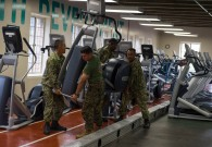 180801-N-KH214-0091 SEATTLE (Aug. 1, 2018) Sailors from the amphibious transport dock ship USS Somerset (LPD 25) and Marines from 2nd Battalion, 7th Marines, Marine Corps Air Ground Combat Center help lift an elliptical machine at the local YMCA in downtown Seattle as part of the 69th annual Seafair Fleet Week. Seafair Fleet Week is an annual celebration of the sea services wherein Sailors, Marines and Coast Guard members from visiting U.S. Navy and Coast Guard ships and ships from Canada make the city a port of call. (U.S. Navy photo by Mass Communication Specialist 2nd Class Scott Wood/Released)