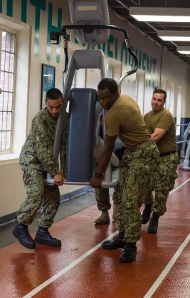 180801-N-KH214-0122 SEATTLE (Aug. 1, 2018) Sailors from the amphibious transport dock ship USS Somerset (LPD 25) and Marines from 2nd Battalion, 7th Marines, Marine Corps Air Ground Combat Center lift an elliptical machine at the local YMCA in downtown Seattle as part of the 69th annual Seafair Fleet Week. Seafair Fleet Week is an annual celebration of the sea services wherein Sailors, Marines and Coast Guard members from visiting U.S. Navy and Coast Guard ships and ships from Canada make the city a port of call. (U.S. Navy photo by Mass Communication Specialist 2nd Class Scott Wood/Released)