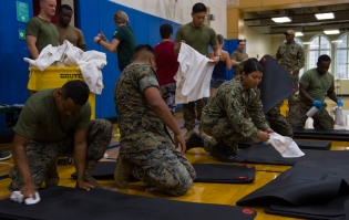 180801-N-KH214-0172 SEATTLE (Aug. 1, 2018) Sailors from the amphibious transport dock ship USS Somerset (LPD 25) and Marines from 2nd Battalion, 7th Marines, Marine Corps Air Ground Combat Center clean exercise mats at the local YMCA in downtown Seattle as part of the 69th annual Seafair Fleet Week. Seafair Fleet Week is an annual celebration of the sea services wherein Sailors, Marines and Coast Guard members from visiting U.S. Navy and Coast Guard ships and ships from Canada make the city a port of call. (U.S. Navy photo by Mass Communication Specialist 2nd Class Scott Wood/Released)