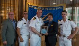 180801-N-KH214-0276 SEATTLE (Aug. 1, 2018) Seattle Navy League President Jeff Davis presents a plaque of appreciation to Lt. Cmdr. Donald Thomson-Greiff, commanding officer of the Canadian Kingston-class coastal defense vessel HMCS Yellowknife (MM 706), for participating in the 69th annual Seafair Fleet Week during the Seattle Navy League Welcome Dinner held at the World Trade Center in downtown Seattle. Seafair Fleet Week is an annual celebration of the sea services wherein Sailors, Marines and Coast Guard members from visiting U.S. Navy and Coast Guard ships and ships from Canada make the city a port of call. (U.S. Navy photo by Mass Communication Specialist 2nd Class Scott Wood/Released)