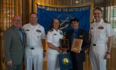 180801-N-KH214-0284 SEATTLE (Aug. 1, 2018) Seattle Navy League President Jeff Davis presents a plaque of appreciation to Cmdr. Elaine Brunelle, commanding officer of the guided-missile destroyer USS Momsen (DDG 92), for participating in the 69th annual Seafair Fleet Week during the Seattle Navy League Welcome Dinner held at the World Trade Center in downtown Seattle. Seafair Fleet Week is an annual celebration of the sea services wherein Sailors, Marines and Coast Guard members from visiting U.S. Navy and Coast Guard ships and ships from Canada make the city a port of call. (U.S. Navy photo by Mass Communication Specialist 2nd Class Scott Wood/Released)