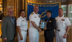 180801-N-KH214-0286 SEATTLE (August 1, 2018) Seattle Navy League President Jeff Davis presents a plaque of appreciation to Capt. Brian Quin, commanding officer of amphibious transport dock ship USS Somerset (LPD 25), for participating in the 69th annual Seafair Fleet Week during the Seattle Navy League Welcome Dinner held at the World Trade Center in downtown Seattle. Seafair Fleet Week is an annual celebration of the sea services wherein Sailors, Marines and Coast Guard members from visiting U.S. Navy and Coast Guard ships and ships from Canada make the city a port of call. (U.S. Navy photo by Mass Communication Specialist 2nd Class Scott Wood/Released)