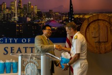 180801-N-SH284-035 SEATTLE (Aug. 1, 2018) Rear Adm. Don Gabrielson, commander, Carrier Strike Group (CSG) 11, receives a gift from Seattle's Deputy Mayor Mike Fong at the Seattle Mayor's reception during the 69th annual Seafair Fleet Week. Seafair Fleet Week is an annual celebration of the sea services wherein Sailors, Marines and Coast Guard members from visiting U.S. Navy and Coast Guard ships and ships from Canada make the city a port of call. (U.S. Navy photo by Mass Communication Specialist 2nd Class Vaughan Dill/Released)