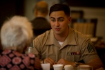 180802-M-OI329-1016 SEATTLE (Aug. 2, 2018) U.S Marine Corps Sgt. Justus Breanson speaks with a resident of The Garden Club Retirement Community during Seafair Fleet Week. Seafair Fleet Week is an annual celebration of the sea services wherein Sailors, Marines and Coast Guard members from visiting U.S. Navy and Coast Guard ships and ships from Canada make the city a port of call. (U.S. Marine Corps photo by Cpl. Joseph Prado)