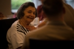 180802-M-OI329-1692 SEATTLE (August 2, 2018) A resident of The Garden Club Retirement Community speaks with Marines during Seafair Fleet Week. Seafair Fleet Week is an annual celebration of the sea services wherein Sailors, Marines and Coast Guard members from visiting U.S. Navy and Coast Guard ships and ships from Canada make the city a port of call. (U.S. Marine Corps photo by Cpl. Joseph Prado)