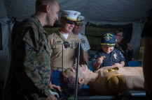 180802-N-DA737-0203 SEATTLE (Aug. 2, 2018) Joe Savage, Port of Seattle Police Department Chief for a Day, is shown a mannequin in the Bravo Surgical Company display aboard amphibious transport dock ship USS Somerset (LPD 25). Somerset is in port in Seattle for Seafair Fleet Week, an annual celebration of the sea services wherein Sailors, Marines and Coast Guard members from visiting U.S. Navy and Coast Guard ships and ships from Canada make the city a port of call. (U.S. Navy photo by Mass Communication Specialist 2nd Class Jonathan Jiang/Released)