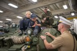 180802-N-DA737-0413 SEATTLE (Aug. 2, 2018) Joe Savage, (right) Port of Seattle Police Department Chief for a Day, and his brother, Isaac, (left), sit atop an LAV 25 Light Armored Vehicle aboard the amphibious transport dock ship USS Somerset (LPD 25). Somerset is in port in Seattle for Seafair Fleet Week, an annual celebration of the sea services wherein Sailors, Marines and Coast Guard members from visiting U.S. Navy and Coast Guard ships and ships from Canada make the city a port of call. (U.S. Navy photo by Mass Communication Specialist 2nd Class Jonathan Jiang/Released)