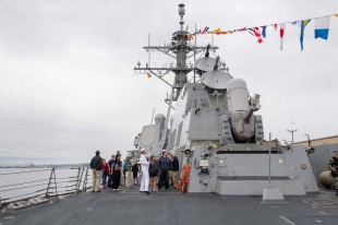 180802-N-DA737-0472 SEATTLE (Aug. 2, 2018) Interior Communications Electrician 1st Class Donald Evans leads a tour aboard the guided-missile destroyer USS Momsen (DDG 92) as part of Seattle Seafair Fleet Week. Seafair Fleet Week is an annual celebration of the sea services wherein Sailors, Marines and Coast Guard members from visiting U.S. Navy and Coast Guard ships and ships from Canada make the city a port of call. (U.S. Navy photo by Mass Communication Specialist 2nd Class Jonathan Jiang/Released)