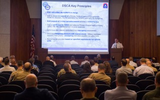 180802-N-KH214-0031 SEATTLE (Aug. 2, 2018) Col. David Spess, deputy defense coordinating officer at Defense Coordinating Element Region X, speaks during the Seattle Seafair Defense Support of Civil Authorities (DSCA) Senior Leadership Engagement Session at the Jackson Federal Building in downtown Seattle. Seafair Fleet Week is an annual celebration of the sea services wherein Sailors, Marines and Coast Guard members from visiting U.S. Navy and Coast Guard ships and ships from Canada make the city a port of call. (U.S. Navy photo by Mass Communication Specialist 2nd Class Scott Wood/Released)