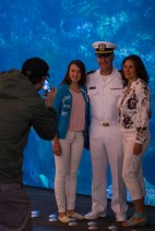 180802-N-SH284-0106 SEATTLE (August 02, 2018) Lt. Brandon Korter, a Navy Region Northwest chaplain poses for a photo with visitors at the Seattle Aquarium, where the Naval Station Everett dive locker presented a static display, during the 69th annual Seafair Fleet Week. during the 69th annual Seafair Fleet Week. Seafair Fleet Week is an annual celebration of the sea services wherein Sailors, Marines and Coast Guard members from visiting U.S. Navy and Coast Guard ships and ships from Canada make the city a port of call. (U.S. Navy photo by Mass Communication Specialist 2nd Class Vaughan Dill/Released)
