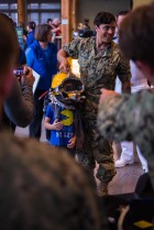 180802-N-SH284-0162 SEATTLE (August 02, 2018) Navy Diver 2nd Class Tyler McLaughlin helps a child try on a dive helmet at a static display presented by the Naval Station Everett dive locker at the Seattle Aquarium during the 69th annual Seafair Fleet Week. Seafair Fleet Week is an annual celebration of the sea services wherein Sailors, Marines and Coast Guard members from visiting U.S. Navy and Coast Guard ships and ships from Canada make the city a port of call. (U.S. Navy photo by Mass Communication Specialist 2nd Class Vaughan Dill/Released)