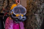 180802-N-SH284-0179 SEATTLE (August 02, 2018) A child tries on a dive helmet at a static display presented by the Naval Station Everett dive locker at the Seattle Aquarium during the 69th annual Seafair Fleet Week. Seafair Fleet Week is an annual celebration of the sea services wherein Sailors, Marines and Coast Guard members from visiting U.S. Navy and Coast Guard ships and ships from Canada make the city a port of call. (U.S. Navy photo by Mass Communication Specialist 2nd Class Vaughan Dill/Released)