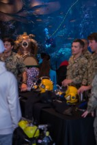 180802-N-SH284-0189 SEATTLE (August 02, 2018) Members of the Naval Station Everett dive locker interact with visitors at the Seattle Aquarium while a diver swims in the main tank during the 69th annual Seafair Fleet Week. Seafair Fleet Week is an annual celebration of the sea services wherein Sailors, Marines and Coast Guard members from visiting U.S. Navy and Coast Guard ships and ships from Canada make the city a port of call. (U.S. Navy photo by Mass Communication Specialist 2nd Class Vaughan Dill/Released)