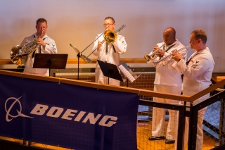 180802-N-SH284-1012 SEATTLE (August 2, 2018) Navy Band Northwest's brass quintet performs for an audience at the Seattle Seafair Air Show Reception held at the Seattle Aquarium during the 69th annual Seafair Fleet Week. Seafair Fleet Week is an annual celebration of the sea services wherein Sailors, Marines and Coast Guard members from visiting U.S. Navy and Coast Guard ships and ships from Canada make the city a port of call. (U.S. Navy photo by Mass Communication Specialist 2nd Class Vaughan Dill/Released)