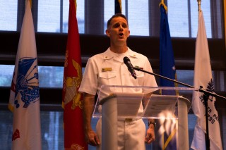 180802-N-SH284-1068 SEATTLE (August 2, 2018) Chief Musician Evan Vis, assigned to Navy Band Northwest, sings the National Anthem at the Seattle Seafair Air Show Reception held at the Seattle Aquarium during the 69th annual Seafair Fleet Week. Seafair Fleet Week is an annual celebration of the sea services wherein Sailors, Marines and Coast Guard members from visiting U.S. Navy and Coast Guard ships and ships from Canada make the city a port of call. (U.S. Navy photo by Mass Communication Specialist 2nd Class Vaughan Dill/Released)