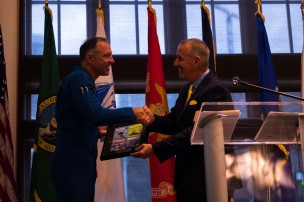 180802-N-SH284-1090 SEATTLE (August 2, 2018) Cmdr. Eric Doyle, commanding officer, Navy flight demonstration squadron, the Blue Angels, accepts a plaque from Richard Andersen, Seafair president and CEO, at the Seattle Seafair Air Show Reception held at the Seattle Aquarium during the 69th annual Seafair Fleet Week. Seafair Fleet Week is an annual celebration of the sea services wherein Sailors, Marines and Coast Guard members from visiting U.S. Navy and Coast Guard ships and ships from Canada make the city a port of call. (U.S. Navy photo by Mass Communication Specialist 2nd Class Vaughan Dill/Released)