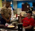 180803-M-OI329-1006 SEATTLE (Aug. 3, 2018) U.S Marines and Sailors visit the Veteran's Affairs Puget Sound Health Care System during Seafair Fleet Week in Seattle. Seafair Fleet Week is an annual celebration of the sea services wherein Sailors, Marines and Coast Guard members from visiting U.S. Navy and Coast Guard ships and ships from Canada make the city a port of call. (U.S. Marine Corps photo by Cpl. Joseph Prado)