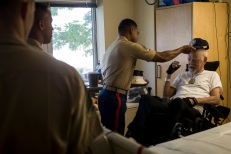 180803-M-OI329-1011 SEATTLE (Aug. 3, 2018) U.S Marines and Sailors visit the Veteran's Affairs Puget Sound Health Care System during Seafair Fleet Week in Seattle. Seafair Fleet Week is an annual celebration of the sea services wherein Sailors, Marines and Coast Guard members from visiting U.S. Navy and Coast Guard ships and ships from Canada make the city a port of call. (U.S. Marine Corps photo by Cpl. Joseph Prado)