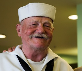 180803-M-ST406-1010 SEATTLE ( August 3, 2018) Robert Imari, a U.S. Navy veteran, poses for a picture during Seafair Fleet Week. Seafair Fleet Week is an annual celebration of the sea services wherein Sailors, Marines and Coast Guard members from visiting U.S. Navy and Coast Guard ships and ships from Canada make the city a port of call. ( U.S. Marine Corps photo by Lance Cpl. Ana S. Madrigal)