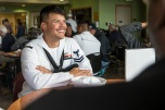 180803-M-ST406-1029 SEATTLE ( August 1, 2018) U.S. Navy Petty Officer 2nd Class Christopher Cruz assigned to amphibious transport dock ship USS Somerset (LPD 25) , interacts with veterans at the Pike Place Senior Center during Seafair Fleet Week. Seafair Fleet Week is an annual celebration of the sea services wherein Sailors, Marines and Coast Guard members from visiting U.S. Navy and Coast Guard ships and ships from Canada make the city a port of call. ( U.S. Marine Corps photo by Lance Cpl. Ana S. Madrigal)