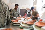 180804-N-DA737-0009 SEATTLE (August 4, 2018) Air Traffic Controller Airman Jodanny Zelaya and Cryptologic Technician (Collection) 3rd Class Chris Best, both assigned to amphibious transport dock ship USS Somerset (LPD 25), prepare meals at Union Gospel Mission during a Seattle's Seafair Fleet Week community relations event. Seafair Fleet Week is an annual celebration of the sea services wherein Sailors, Marines and Coast Guard members from visiting U.S. Navy and Coast Guard ships and ships from Canada make the city a port of call. (U.S. Navy photo by Mass Communication Specialist 2nd Class Jonathan Jiang/Released)