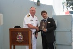 180804-N-DA737-0069 SEATTLE (August 4, 2018) Capt. Steve Jorgensen, deputy commander of Canadian Fleet Pacific, presents a plaque to Seattle Navy League President Jeff Davis during a reception held aboard Kingston-class coastal defense vessels HMCS Whitehorse (710) and HMCS Yellowknife (706) during Seattle's Seafair Fleet Week. Seafair Fleet Week is an annual celebration of the sea services wherein Sailors, Marines and Coast Guard members from visiting U.S. Navy and Coast Guard ships and ships from Canada make the city a port of call. (U.S. Navy photo by Mass Communication Specialist 2nd Class Jonathan Jiang/Released)