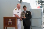 180804-N-DA737-0078 SEATTLE (August 4, 2018) Capt. Steve Jorgensen, deputy commander of Canadian Fleet Pacific, receives a plaque from Seattle Navy League President Jeff Davis during a reception held aboard Kingston-class coastal defense vessels HMCS Whitehorse (710) and HMCS Yellowknife (706) during Seattle's Seafair Fleet Week. Seafair Fleet Week is an annual celebration of the sea services wherein Sailors, Marines and Coast Guard members from visiting U.S. Navy and Coast Guard ships and ships from Canada make the city a port of call. (U.S. Navy photo by Mass Communication Specialist 2nd Class Jonathan Jiang/Released)