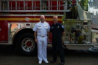 180804-N-SH284-0006 SEATTLE (Aug. 4, 2018) Vice Adm. John D. Alexander, commander, U.S. 3rd Fleet, poses for a photo with firefighter Rich Cochrane at Seattle Firehouse #40 during the 69th annual Seafair Fleet Week. Cochrane, a former Lt. Cmdr., worked for Alexander on USS Abraham Lincoln (CVN 72), and Alexander wrote the letter of recommendation that assisted Cochrane in landing a job as a Seattle firefighter. Seafair Fleet Week is an annual celebration of the sea services wherein Sailors, Marines and Coast Guard members from visiting U.S. Navy and Coast Guard ships and ships from Canada make the city a port of call. (U.S. Navy photo by Mass Communication Specialist 2nd Class Vaughan Dill/Released)
