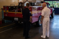 180804-N-SH284-0019 SEATTLE (Aug. 4, 2018) Vice Adm. John D. Alexander, commander, U.S. 3rd Fleet, receives a tour of Seattle Firehouse #40 from firefighter Rich Cochrane during the 69th annual Seafair Fleet Week. Cochrane, a former Lt. Cmdr., worked for Alexander on USS Abraham Lincoln (CVN 72), and Alexander wrote the letter of recommendation that assisted Cochrane in landing a job as a Seattle firefighter. Seafair Fleet Week is an annual celebration of the sea services wherein Sailors, Marines and Coast Guard members from visiting U.S. Navy and Coast Guard ships and ships from Canada make the city a port of call. (U.S. Navy photo by Mass Communication Specialist 2nd Class Vaughan Dill/Released)