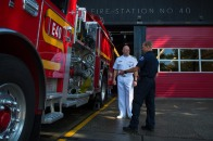 180804-N-SH284-0041 SEATTLE (Aug. 4, 2018) Vice Adm. John D. Alexander, commander, U.S. 3rd Fleet, receives a tour of Seattle Firehouse #40 from firefighter Rich Cochrane during the 69th annual Seafair Fleet Week. Cochrane, a former Lt. Cmdr., worked for Alexander on USS Abraham Lincoln (CVN 72), and Alexander wrote the letter of recommendation that assisted Cochrane in landing a job as a Seattle firefighter. Seafair Fleet Week is an annual celebration of the sea services wherein Sailors, Marines and Coast Guard members from visiting U.S. Navy and Coast Guard ships and ships from Canada make the city a port of call. (U.S. Navy photo by Mass Communication Specialist 2nd Class Vaughan Dill/Released)