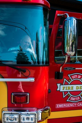 180804-N-SH284-0066 SEATTLE (Aug. 4, 2018) Vice Adm. John D. Alexander, commander, U.S. 3rd Fleet, sits in the driver's seat of Engine 40, as part of a tour of Seattle Firehouse #40 from firefighter Rich Cochrane during the 69th annual Seafair Fleet Week. Cochrane, a former Lt. Cmdr., worked for Alexander on USS Abraham Lincoln (CVN 72), and Alexander wrote the letter of recommendation that assisted Cochrane in landing a job as a Seattle firefighter. Seafair Fleet Week is an annual celebration of the sea services wherein Sailors, Marines and Coast Guard members from visiting U.S. Navy and Coast Guard ships and ships from Canada make the city a port of call. (U.S. Navy photo by Mass Communication Specialist 2nd Class Vaughan Dill/Released)