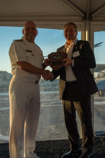 180804-N-SH284-2013 SEATTLE (August 4, 2018) Vice Adm. John D. Alexander, commander, U.S. 3rd Fleet, presents a plaque to Stephen Metruck, executive director, Port of Seattle, at the 3rd Fleet Reception aboard amphibious transport dock ship USS Somerset (LPD 25) during the 69th annual Seafair Fleet Week. Seafair Fleet Week is an annual celebration of the sea services wherein Sailors, Marines and Coast Guard members from visiting U.S. Navy and Coast Guard ships and ships from Canada make the city a port of call. (U.S. Navy photo by Mass Communication Specialist 2nd Class Vaughan Dill/Released)