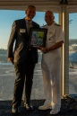 180804-N-SH284-2022 SEATTLE (August 4, 2018) Vice Adm. John D. Alexander, commander, U.S. 3rd Fleet, receives a plaque from Richard Andersen, Seafair President & CEO, at the 3rd Fleet Reception aboard amphibious transport dock ship USS Somerset (LPD 25) during the 69th annual Seafair Fleet Week. Seafair Fleet Week is an annual celebration of the sea services wherein Sailors, Marines and Coast Guard members from visiting U.S. Navy and Coast Guard ships and ships from Canada make the city a port of call. (U.S. Navy photo by Mass Communication Specialist 2nd Class Vaughan Dill/Released)