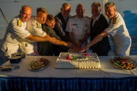 180804-N-SH284-2052 SEATTLE (August 4, 2018) Rear Adm. Scott Gray, commander, Navy Region Northwest, Rear Adm. Don Gabrielson, commander, Carrier Strike Group 11, Jeff Davis, president, Seattle Navy League, Richard Andersen, Seafair President & CEO, Vice Adm. John D. Alexander, commander, U.S. 3rd Fleet, Stephen Metruck, executive director, Port of Seattle, and Capt. Brian J. Quin, commanding officer, amphibious transport dock ship USS Somerset (LPD 25) cut a cake at the 3rd Fleet Reception aboard USS Somerset during the 69th annual Seafair Fleet Week. Seafair Fleet Week is an annual celebration of the sea services wherein Sailors, Marines and Coast Guard members from visiting U.S. Navy and Coast Guard ships and ships from Canada make the city a port of call. (U.S. Navy photo by Mass Communication Specialist 2nd Class Vaughan Dill/Released)