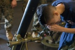 180805-M-ST406-1039 SEATTLE ( August 5, 2018) A child examines equipment during a tour aboard amphibious transport dock ship USS Somerset (LPD 25) during Seattle Fleet Week. Seafair Fleet Week is an annual celebration of the sea services wherein Sailors, Marines and Coast Guard members from visiting U.S. Navy and Coast Guard ships and ships from Canada make the city a port of call. ( U.S. Marine Corps photo by Lance Cpl. Ana S. Madrigal)