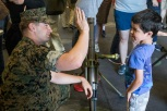 180805-M-ST406-1062 SEATTLE ( August 5, 2018) U.S. Marine Corps Cpl. Matthew Mikyska, a mortarman with 2nd Battalion, 7th Marine Regiment, high-fives a child during Seattle Fleet Week. Seafair Fleet Week is an annual celebration of the sea services wherein Sailors, Marines and Coast Guard members from visiting U.S. Navy and Coast Guard ships and ships from Canada make the city a port of call. (U.S. Marine Corps photo by Lance Cpl. Ana S. Madrigal)