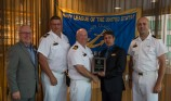 180801-N-KH214-0278 SEATTLE (August 1, 2018) Seattle Navy League President Jeff Davis presents a plaque of appreciation to Lt. Cmdr. Jeff Chura, commanding officer of the Canadian Kingston-class coastal defense vessel HMCS Whitehorse (MM 705), for participating in the 69th annual Seafair Fleet Week during the Seattle Navy League Welcome Dinner held at the World Trade Center in downtown Seattle. Seafair Fleet Week is an annual celebration of the sea services wherein Sailors, Marines and Coast Guard members from visiting U.S. Navy and Coast Guard ships and ships from Canada make the city a port of call. (U.S. Navy photo by Mass Communication Specialist 2nd Class Scott Wood/Released)