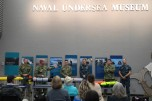 181103-N-NP779-0026 KEYPORT, Wash. (Nov. 3, 2018) Cmdr. Scott J. Smith, commanding officer, Unmanned Undersea Vehicle Squadron One (UUVRON 1), introduces his team to the audience during Deep Sea Day at the United States Naval Undersea Museum (USNUM). USNUM is dedicated to educating the public about the U.S. Navy's undersea operations, technology, combat, research, and salvage operations. (U.S. Navy photo by Mass Communication Specialist 1st Class Ty Connors/Released)
