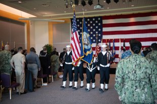 181108-N-DA737-0014 EVERETT, Wash. (Nov. 8, 2018) Naval Station Everett's (NSE) honor guard retire the colors during the annual NSE Veterans Day ceremony. Veterans Day honors veterans, past and present, who have served in the United States Armed Forces. (U.S. Navy photo by Mass Communication Specialist 2nd Class Jonathan Jiang/Released)