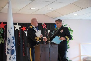 181109-N-DA737-0029 SHORELINE, Wash. (Nov. 9, 2018) Retired Army Lt. Col. Roger H. Hammer introduces Navy Capt. Mike Davis, commanding officer of Naval Station Everett, as the keynote speaker during the Shoreline-Lake Forest Park Senior Recreation Center Veterans Day Tribute Program. The event was held by Shoreline-Lake Forest Park to honor veterans both past and present. (U.S. Navy photo by Mass Communication Specialist 2nd Class Jonathan Jiang/Released)