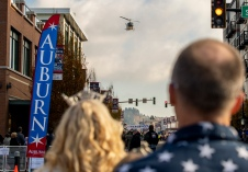 181110-N-ZP059-0005 AUBURN, Wash. (Nov. 10, 2018) A King County Sheriff helicopter flies over Main Street in Auburn, Wash., to kick off the start of the 53rd annual Veterans Day Parade. The mile-long parade featured more than 200 entries, including drill teams, veterans' floats, marching bands, and antique military vehicles. (U.S. Navy photo by Mass Communication Specialist 2nd Class Jacob G. Sisco/Released)