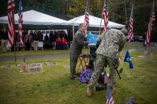 181111-N-EH218-0055 GARDINER, Wash. (Nov. 11, 2018) Retired Seabee Master Chief Rick Bravo (left) and Chief Steelworker Jason Lum present a Medal of Honor flower box during a memorial honoring Construction Mechanic 3rd Class Marvin Glenn Shields at Gardiner Cemetery. The ceremony paid tribute to the only Seabee Medal of Honor recipient and Vietnam veteran, Shields, who was posthumously awarded the nation's highest military award for his actions and for giving his life to save comrades while under enemy attack. (U.S. Navy photo by Mass Communication Specialist 1st Class Ryan J. Batchelder/Released)