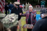 181111-N-EH218-0124 GARDINER, Wash. (Nov. 11, 2018) Mrs. Joan Shields-Bennett, widow of Construction Mechanic 3rd Class Marvin Glenn Shields, describes the tributes left on the grave of her late husband after a Veterans Day ceremony hosted by Naval Facilities Engineering Command Northwest at Gardiner Cemetery. The ceremony paid tribute to the only Seabee Medal of Honor recipient and Vietnam veteran, Shields, who was posthumously awarded the nation's highest military award for his actions and for giving his life to save comrades while under enemy attack. (U.S. Navy photo by Mass Communication Specialist 1st Class Ryan J. Batchelder/Released)