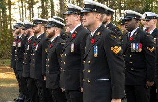 181111-N-KH214-0121 OAK HARBOR, Wash. (Nov. 11, 2018) Service members representing the United States Navy, Canadian Navy, Royal Australian Air Force, and Royal Air Force stand in formation during the Remembrance and Veterans Day Ceremony held at the Veterans of Foreign Wars on Whidbey Island. Remembrance and Veterans Day are annual holidays celebrated by the Commonwealth of Nations and the United States to observe and honor the sacrifices of those who have served in the military. (U.S. Navy photo by Mass Communication Specialist 2nd Class Scott Wood/Released)