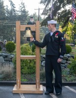 181111-N-KH214-0146 OAK HARBOR, Wash. (Nov. 11, 2018) Aviation Electronics Technician 3rd Class Colin Butler, assigned to Naval Air Station (NAS) Whidbey Island, rings 21 bells during the Remembrance and Veterans Day Ceremony held at the Veterans of Foreign Wars on Whidbey Island. Remembrance and Veterans Day are annual holidays celebrated by the Commonwealth of Nations and the United States to observe and honor the sacrifices of those who have served in the military. (U.S. Navy photo by Mass Communication Specialist 2nd Class Scott Wood/Released)