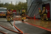 181115-N-SH284-0185 SILVERDALE, Wash. (Nov. 15, 2018) Firefighters for the Bremerton Fire Department retract hose from a fire simulator during a joint live fire training onboard Naval Base Kitsap-Bangor. The joint live fire training brought together firefighters from Navy Region Northwest Fire and Emergency Services, Central Kitsap Fire Rescue, and the Bremerton Fire Department, to practice their skills inside the Naval Base Kitsap-Bangor live fire simulator. (U.S. Navy photo by Mass Communication Specialist 2nd Class Vaughan Dill/Released)
