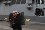 181121-N-YB023-0028 EVERETT, Wash. (Nov. 21, 2018) A Sailor assigned to the guided-missile destroyer USS Shoup (DDG 86) is greeted by his spouse upon returning from deployment at Naval Station Everett (NSE). Shoup returned to NSE from a cooperative Western Pacific deployment after supporting the Oceania Maritime Security Initiative to enhance regional security and interoperability with partner nations. (U.S. Navy photo by Mass Communication Specialist 3rd Class Clemente Lynch/Released)