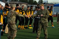 181207-N-SH284-0028 JOINT BASE LEWIS-MCCHORD, Wash. (Dec. 7, 2018) Capt. Alan Schrader, right, commanding officer of Naval Base Kitsap, shares a pregame handshake with Army Col. Nicole Lucas, Joint Base Lewis-McChord (JBLM) Garrison Commander, prior to the 19th annual Army/Navy flag football game at JBLM's Cowan Stadium. The game, which is held ahead of the college football rivalry game between the U.S. Naval Academy and U.S. Military Academy, was won by Navy 20-14, marking the sixth consecutive victory for Navy and 13th victory in 20 games. (U.S. Navy photo by Mass Communication Specialist 2nd Class Vaughan Dill/Released)
