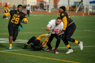 181207-N-SH284-0098 JOINT BASE LEWIS-MCCHORD, Wash. (Dec. 7, 2018) Navy pushes into the end zone for their first touchdown during the 19th annual Army/Navy flag football game at Joint Base Lewis-McChord's Cowan Stadium. The game, which is held ahead of the college football rivalry game between the U.S. Naval Academy and U.S. Military Academy, was won by Navy 20-14, marking the sixth consecutive victory for Navy and 13th victory in 20 games. (U.S. Navy photo by Mass Communication Specialist 2nd Class Vaughan Dill/Released)